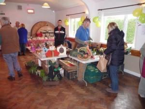The first customer at Bucksum seasonal vegetables and salads. Adjoining it is the Springhill stall